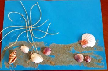 Muscheln Sand und Netz